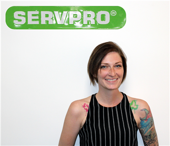 Jamie White Posing for SERVPRO Employee Photo, female in front of white wall