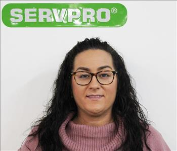 Shannon Bruening Posing for Company Photo Under A SERVPRO Sign