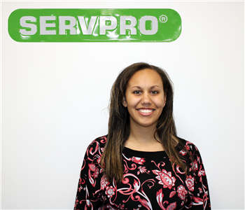 Kaileigh Plant Under The SERVPRO Sign For Her Employee Photo