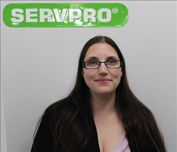 Shannon Soriano Posing for Company Photo Under A SERVPRO Sign